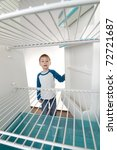boy looking into empty... | Shutterstock . vector #72721687