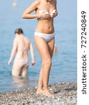 girl in a swimsuit on the beach ... | Shutterstock . vector #727240849