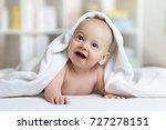 little baby boy lies on belly... | Shutterstock . vector #727278151