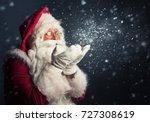 santa claus blowing magic snow... | Shutterstock . vector #727308619