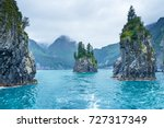 blue waters and tree covered... | Shutterstock . vector #727317349