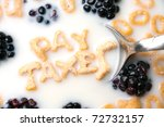The words PAY TAXES spelled out of letter shaped cereal pieces floating in a milk filled cereal bowl. - stock photo