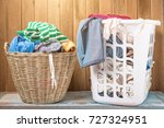 clothes in a laundry wooden... | Shutterstock . vector #727324951