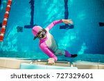 freediving in the pool   woman... | Shutterstock . vector #727329601