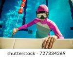 young woman underwater showing  ... | Shutterstock . vector #727334269