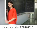 pretty  young college student... | Shutterstock . vector #727348315