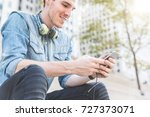 man with phone and headphones... | Shutterstock . vector #727373071
