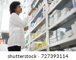 female chemist arranging stock... | Shutterstock . vector #727393114