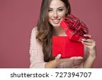 woman with gift | Shutterstock . vector #727394707
