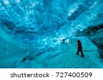 Explorer Inside An Ice Cave ...
