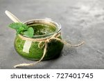 jar with chutney mint sauce on... | Shutterstock . vector #727401745