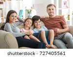 happy family reading books at... | Shutterstock . vector #727405561