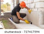 Worker Applies Bitumen Mastic...