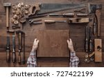 carpenter holding a wood block... | Shutterstock . vector #727422199
