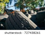 old rubber tires are stacked up ... | Shutterstock . vector #727438261