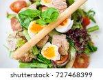 salad nicoise. tuna with baby... | Shutterstock . vector #727468399