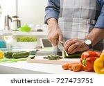 man preparing lunch in the... | Shutterstock . vector #727473751