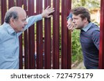 two neighbors takling to each... | Shutterstock . vector #727475179