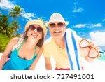 happy young couple with beach... | Shutterstock . vector #727491001