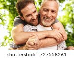 the old man on a wheelchair and ... | Shutterstock . vector #727558261