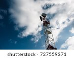 antenna tower with the blue sky ... | Shutterstock . vector #727559371