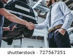 handsome businessman and auto... | Shutterstock . vector #727567351