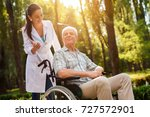 the doctor talks to the old man ... | Shutterstock . vector #727572901