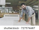 a man in a gray shirt chooses a ... | Shutterstock . vector #727576687