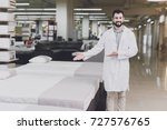 a man in a white coat poses as... | Shutterstock . vector #727576765