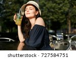 picture of brunette in hat with ... | Shutterstock . vector #727584751