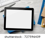 digital tablet on desk   Shutterstock . vector #727596439