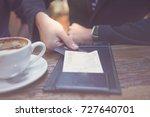 paying the bill. a businessman...   Shutterstock . vector #727640701