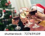 closeup hands holding glass of...   Shutterstock . vector #727659109