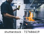 chef cook with frying pan | Shutterstock . vector #727686619