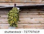 birch brooms on a wooden wall... | Shutterstock . vector #727707619