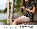 young asian woman holding... | Shutterstock . vector #727709389