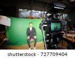 videographer taking video... | Shutterstock . vector #727709404