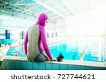 woman freediving in the pool | Shutterstock . vector #727744621