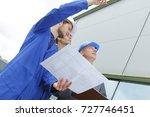 team of builders with... | Shutterstock . vector #727746451
