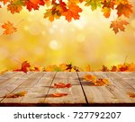autumn maple leaves on wooden ... | Shutterstock . vector #727792207