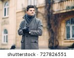 a handsome young man in a warm... | Shutterstock . vector #727826551