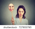 sad woman looking down taking... | Shutterstock . vector #727853785