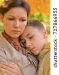 sad mother and son    Shutterstock . vector #727866955