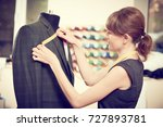 female tailor works with male... | Shutterstock . vector #727893781
