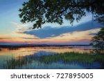 """artistic carolina sunrise""... | Shutterstock . vector #727895005"