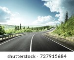 road in north mountain forest | Shutterstock . vector #727915684