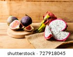 fresh fig and pitahaya on wood... | Shutterstock . vector #727918045