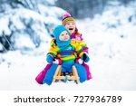 little girl and boy enjoy a... | Shutterstock . vector #727936789
