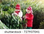family selecting christmas tree.... | Shutterstock . vector #727937041