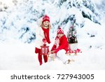 children with christmas tree on ... | Shutterstock . vector #727943005